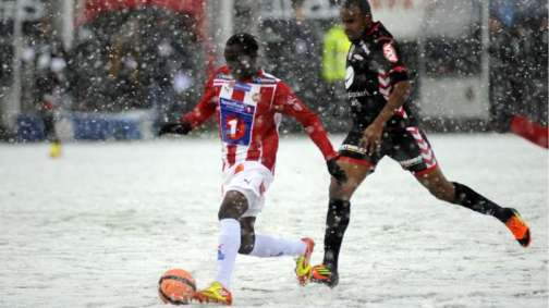 Norwegian Tippeligaen match in heavy snow cover